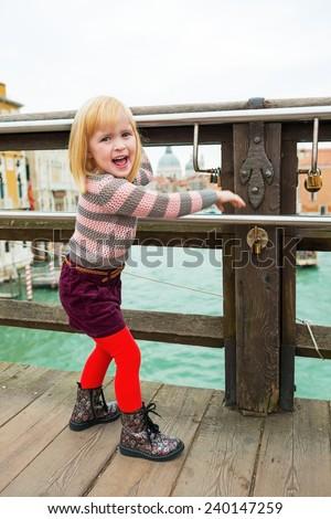 Portrait of baby girl on bridge in venice, italy - stock photo
