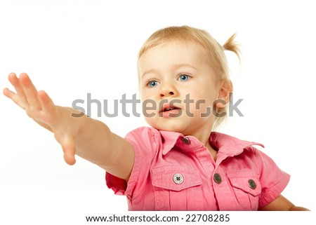 Portrait of baby girl reaching for something