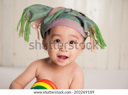 portrait of baby girl with hat scarf fashion - stock photo