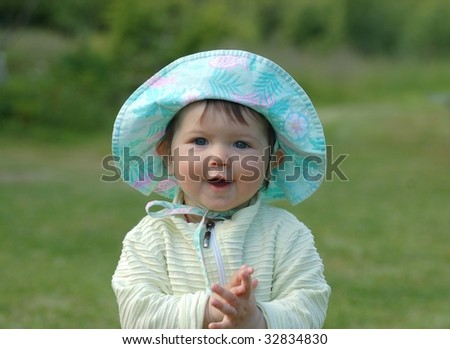 Portrait of baby in blue hat - stock photo