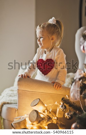 Portrait of baby in Christmas decorations.