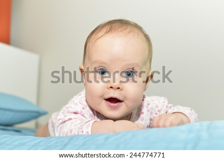 Portrait of  baby on the bed in her room - stock photo