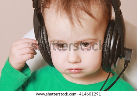 Portrait of baby support phone operator in headset on light  background