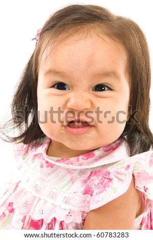 portrait of baby with a very angry expression - stock photo