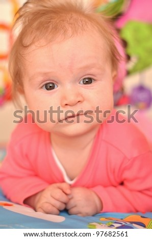 portrait of baby with crazy expression on his face