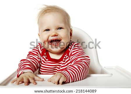 Portrait of baby with dirty mouth after eating.  - stock photo