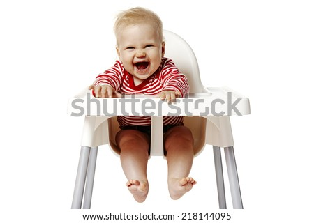 Portrait of baby with dirty mouth after eating. Baby sitting on chair. - stock photo