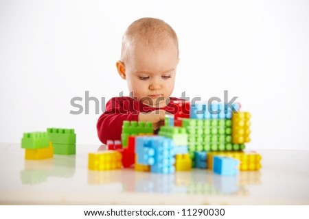 portrait of baby with toys