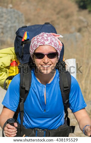 portrait of backpacker girl in mid day