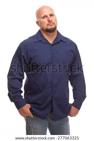 Portrait of bald, handsome young man isolated on white background. Caucasian man with beard who does not look amused. - stock photo