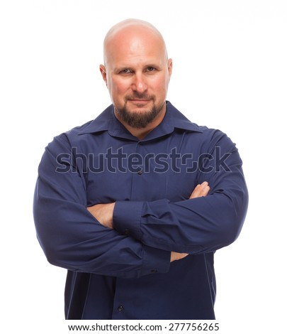 Portrait of bald, handsome young man isolated on white background. Man with arms crossed and smirk on face. - stock photo