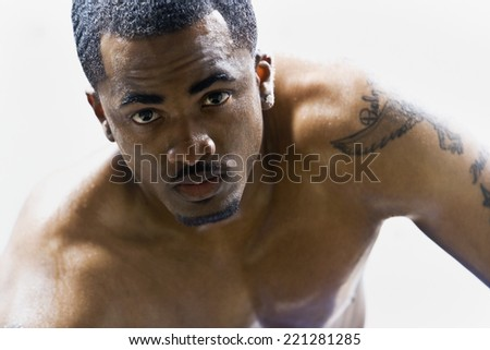 Portrait of bare-chested African American man - stock photo