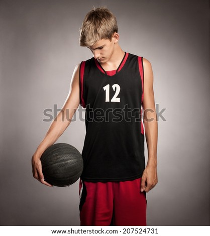 portrait of basketball player on gray background - stock photo