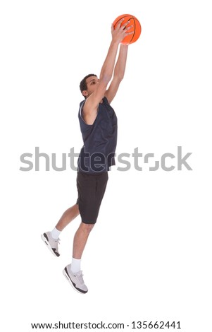 Portrait Of Basketball Sportsman Doing Slam Dank Over White Background - stock photo