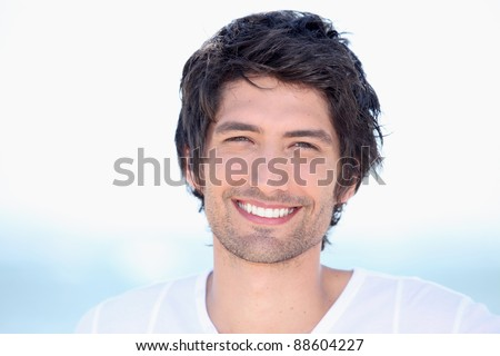 portrait of beaming young man - stock photo