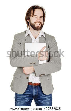 portrait of bearded business man standing with laptop and looking at camera. emotions, facial expressions, feelings, body language, signs. image on a white studio background. - stock photo