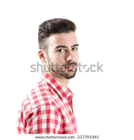 Portrait of bearded man looking at camera isolated over white background. - stock photo