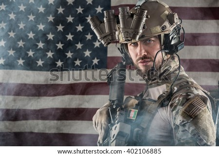 Portrait of Bearded US Army Soldier With Night Vision Goggles on American Flag Background; Smoke Cloud - stock photo