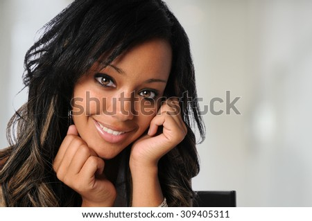Portrait of beautiful African American businesswoman inside office environment - stock photo