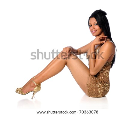 Portrait of beautiful African American woman in golden dress isolated over white background