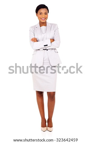 portrait of beautiful african business woman with arms folded - stock photo