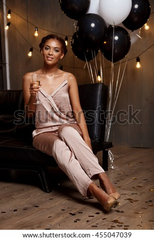Portrait of beautiful african girl resting at party.