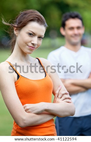 Portrait of beautiful and healthy sporty people outdoors - stock photo