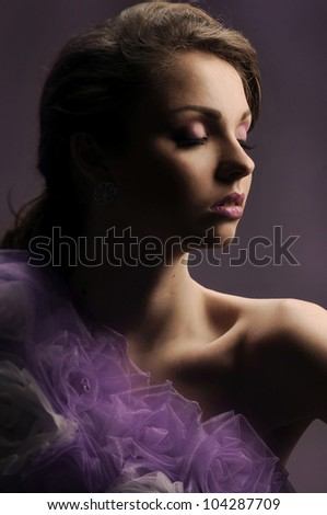 Portrait of beautiful and sexy woman on a dark background - stock photo