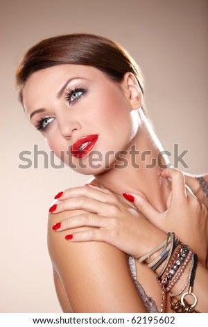 Portrait of beautiful and sexy woman on natural background - stock photo