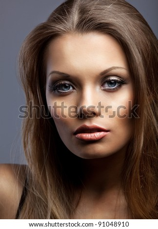 Portrait of beautiful and sexy young serious woman - stock photo