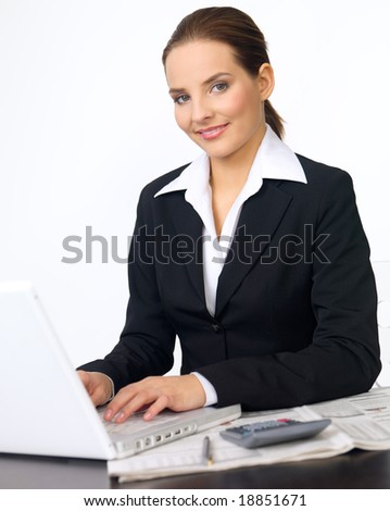 Portrait of beautiful and young business woman working on laptop