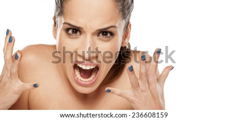 portrait of beautiful  angry woman on a white background - stock photo