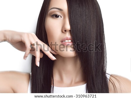Portrait of Beautiful asian brunette girl with healthy long hair isolated on a white background. Beauty Brunette Woman - stock photo