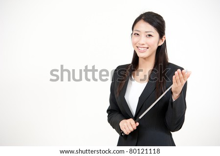 portrait of beautiful asian businesswoman with pointer - stock photo