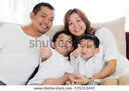 portrait of beautiful asian family - stock photo