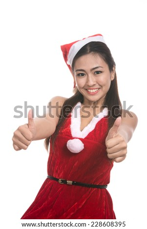 Portrait of beautiful Asian girl(Asian woman) wearing Santa Claus clothes,Santa girl,Christmas girl,x-mas,winter,woman with showing thumbs up gesture,emotion s,isolated on white background - stock photo