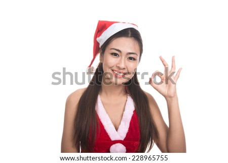 Portrait of beautiful Asian girl(Asian woman) wearing Santa Claus clothes,Santa girl,Christmas girl,x-mas,winter,happiness concept,woman showing OK gesture,emotion s,isolated on white background - stock photo