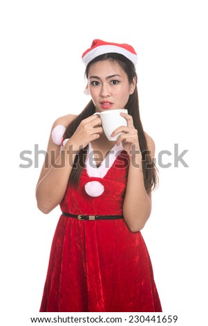 Portrait of beautiful Asian girl(Asian woman) wearing Santa Claus clothes,Santa girl,Christmas girl,x-mas,winter,happiness concept,woman holding cup coffee,emotions,isolated on white background - stock photo