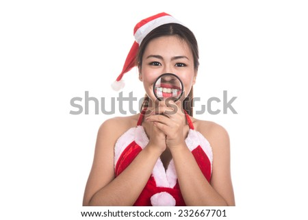 Portrait of beautiful Asian girl(Asian woman) wearing Santa Claus clothes,Santa girl,Christmas girl,x-mas,winter,woman with magnifying glass isolated on white background - stock photo