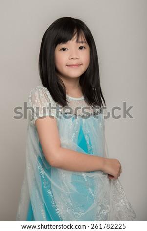 Portrait of Beautiful asian girl wearing blue dress - stock photo