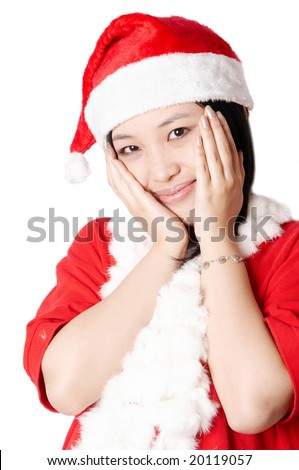 Portrait of beautiful asian girl wearing santa claus clothes on white background - stock photo