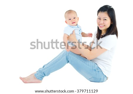 Portrait of beautiful asian mother and baby looking at camera and smile - stock photo