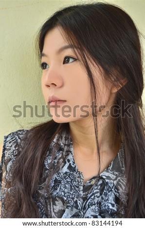 Portrait of beautiful asian woman closeup - stock photo