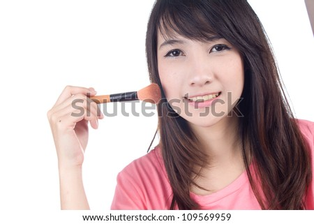 Portrait of beautiful asian woman in casual clothes with makeup brushes on white background