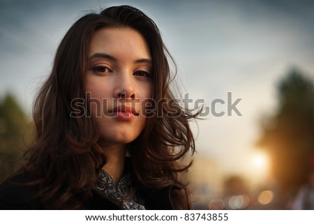 Portrait of beautiful Asian woman in city, closeup on face. - stock photo