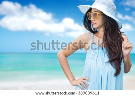 portrait of beautiful asian woman relaxing on the beach on summer holiday