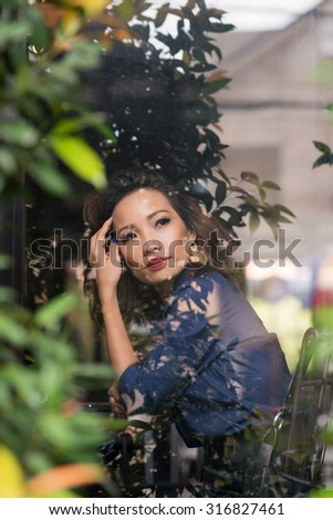 Portrait of beautiful Asian woman resting in cafe