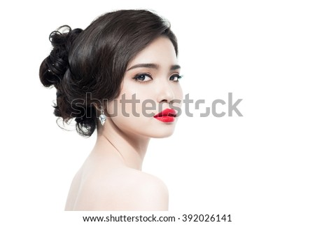 Portrait of Beautiful Asian Woman Wedding Model Isolated on White Background. Advertising and Commercial Design. Shopping. Jewelry - Bridal Earrings, Hairstyle - stock photo