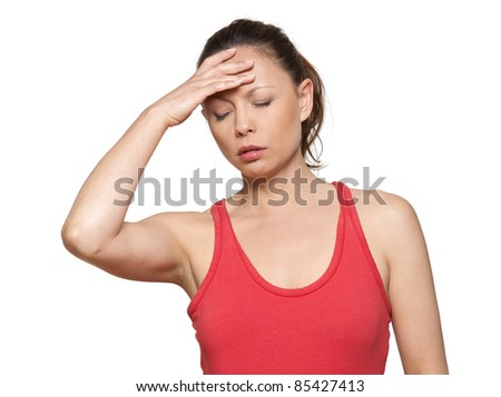 Portrait of beautiful Asian woman with headache in studio isolated on white background - stock photo