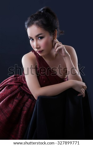 Portrait of beautiful Asian young girl on black background